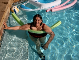 Mom, using a noodle as a flotation device.